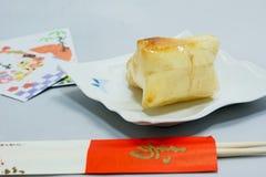palillos cocidos de la torta y de la celebración de arroz para comer el Año Nuevo japonés Fotografía de archivo