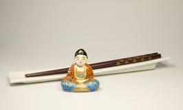 Palillos con Buddha Imágenes de archivo libres de regalías