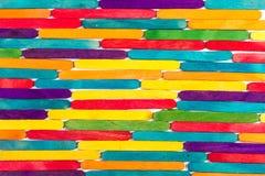 Palillos de madera coloreados Imágenes de archivo libres de regalías