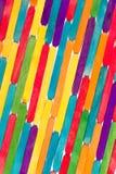 Palillos de madera coloreados Fotos de archivo libres de regalías