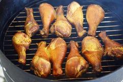 Palillos de pollo ahumados Imágenes de archivo libres de regalías