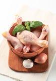 Palillos de pollo sin procesar Foto de archivo