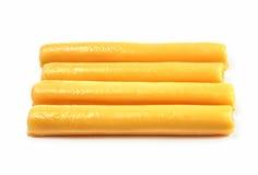Palillos del queso en un fondo blanco Foto de archivo libre de regalías