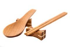Palillos y cucharas de madera Foto de archivo libre de regalías