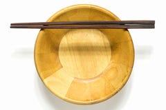 Palillos y cuenco de madera Imágenes de archivo libres de regalías