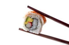 Palillos y sushi Imágenes de archivo libres de regalías