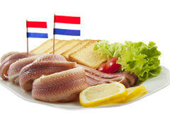 Paling. Fish with toast salat and lemon on a plate Royalty Free Stock Photo
