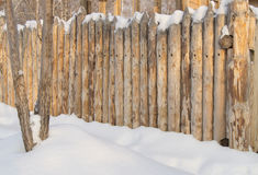 Paling, Wooden fence made of logs in the village, winter Royalty Free Stock Photography