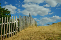 Paling. A wooden long paling along a hill Royalty Free Stock Image