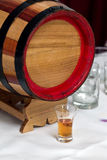 Palinka and barrel Stock Photo