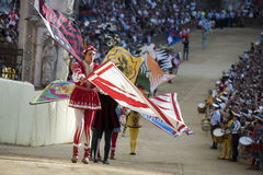 Palio di Siena- Historical parade. SIENA, ITALY - AUGUST 16, 2015 : Historical parade during the horse race Palio di Siena in the medieval square Piazza del royalty free stock photos