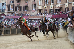 Palio di Siena. SIENA, ITALY - AUGUST 16, 2015 : Riders compete in the horse race Palio di Siena in the medieval square Piazza del Campo in Siena, Italy stock photos
