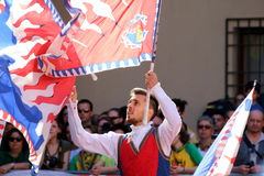Palio - race. Ferrara, Italy - 10 may 2015 -Palio, the city celebrates with competitions of the flag wavers and the parade of the districts. The flag-flyers stock photo