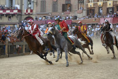 Palio of Siena. Scene from the Palio of Siena, one of the most famous horse races in the world stock images