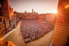 The Palio at Sunset. Sunset view of Piazza del Campo as it is set up for il Palio, a traditional horse race in Siena, a city in Italy's central Tuscany.  The Stock Photos