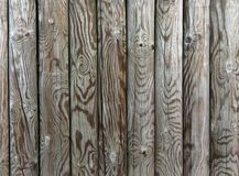 Palisade - fence from wooden stakes. Wooden texture royalty free stock photography