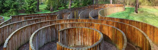 Palisade maze. Panorama of wooden palisade maze in the forest Royalty Free Stock Photos