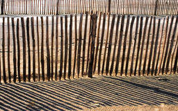 Palisades on sand beach. A wooden palisade on oceanic coast, France Stock Images