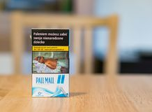 Pall Mall cigarettes. In a box with warning text and photo on a table on circa February 2018 in Poznan, Poland royalty free stock photography