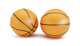 Palla arancio di pallacanestro su un fondo bianco Fotografia Stock