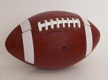 Palla del gioco di football americano Fotografie Stock