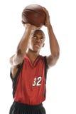 Palla della fucilazione del giocatore di pallacanestro Immagini Stock Libere da Diritti