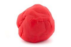 Palla della pasta rossa del gioco su bianco Immagini Stock