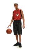 Palla di gocciolamento del giocatore di pallacanestro fotografia stock libera da diritti