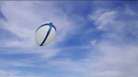 Palla di rugby nella rotazione che passa destra alla sinistra al rallentatore royalty illustrazione gratis