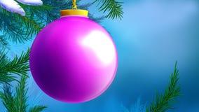 Palla lilla di Natale sopra fondo blu Fotografia Stock
