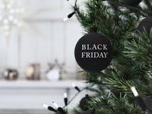 Palla nera di natale di venerdì che appende su un christmastree rappresentazione 3d Fotografie Stock Libere da Diritti