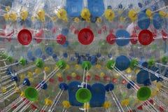Palla-pareggiare trasparente della foto - Zorba con delle le linee radiali colorate multi Fotografia Stock