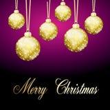 Palla porpora di Buon Natale dell'oro Fotografia Stock Libera da Diritti