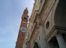 The Palladian Basilica Tower with a Blue Sky in Vicenza, Italy. The Palladian Basilica Clock Tower in Vicenza, Italy with a blue sky Royalty Free Stock Photography