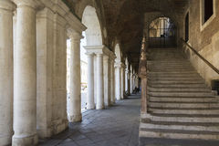 Palladian Basilica. Vicenza,Italy-April 3,2015:view of the particular of the colonnade of the Palladian basilica in the center of Vicenza during a sunny day Stock Images
