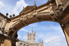 Palladian Bridge in Bath England. Architectural Detail of a Palladian Bridge in Bath England with Bath Abbey in the Background Stock Photography