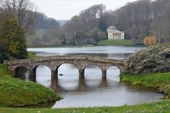 Palladian Bridge, Pantheon and Lake, Stourhead, Stourton, Wiltshire, England. The Palladian Bridge, Pantheon and Lake in Spring, Stourhead, Stourton, Wiltshire Royalty Free Stock Image