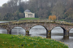 Palladian Bridge, Pantheon and Lake, Stourhead, Stourton, Wiltshire, England. The Palladian Bridge, Pantheon and Lake in Spring, Stourhead, Stourton, Wiltshire Stock Photography