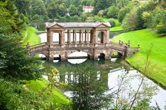 Palladian bridge in Prior Park Landscape Garden. Ornamental Palladian bridge in beautiful and intimate 18th-century landscape garden, one of only four in the Royalty Free Stock Photo