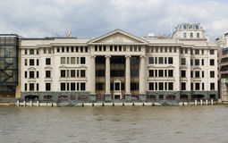 Palladian building, City of London. An impressive palladian style building on the banks of the River Thames beside Southwark Bridge Royalty Free Stock Photography