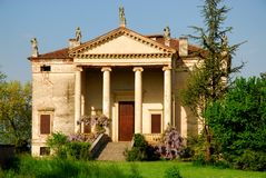 Palladian villa in the green grass and blue sky in the province of Vicenza (Italy) Stock Photo