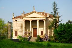 Palladian villa in the green grass and blue sky in the province of Vicenza (Italy) Stock Image
