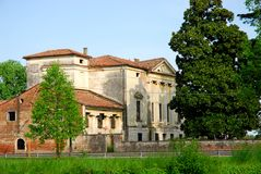 Palladian villa in the green of the grass and leaves and the blue sky in the province of Vicenza (Italy) Stock Images