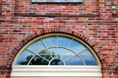 Palladin window and brick wall. Image of a palladin window and brick wall Stock Photography