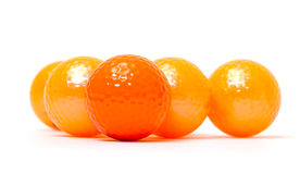 Palle da golf arancio e dorate Immagini Stock
