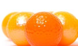 Palle da golf arancio e dorate Fotografie Stock
