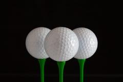 Palle da golf e T di legno di verde Fotografia Stock