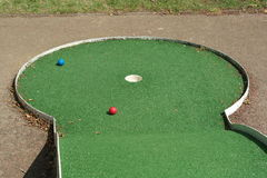 Palle da golf su verde Fotografie Stock