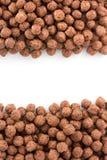 Palle del cioccolato del cereale su bianco Fotografia Stock