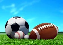 Palle di sport su erba con cielo blu Fotografia Stock